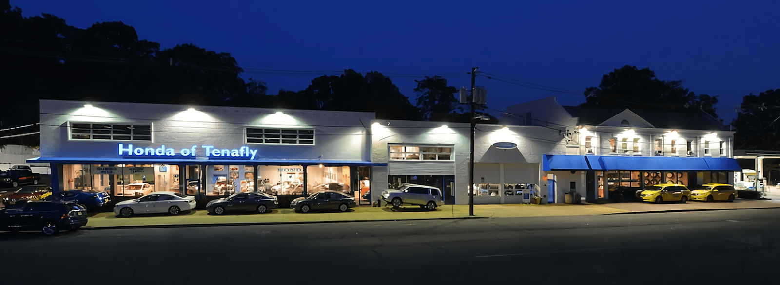 front of dealership at night