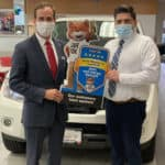 Kelly Automotive Chief Executive Officer, Brian Heney, and Kelly Nissan of Lynnfield Sales Manager, Vinny Varacalli, Pose with CARFAX Award