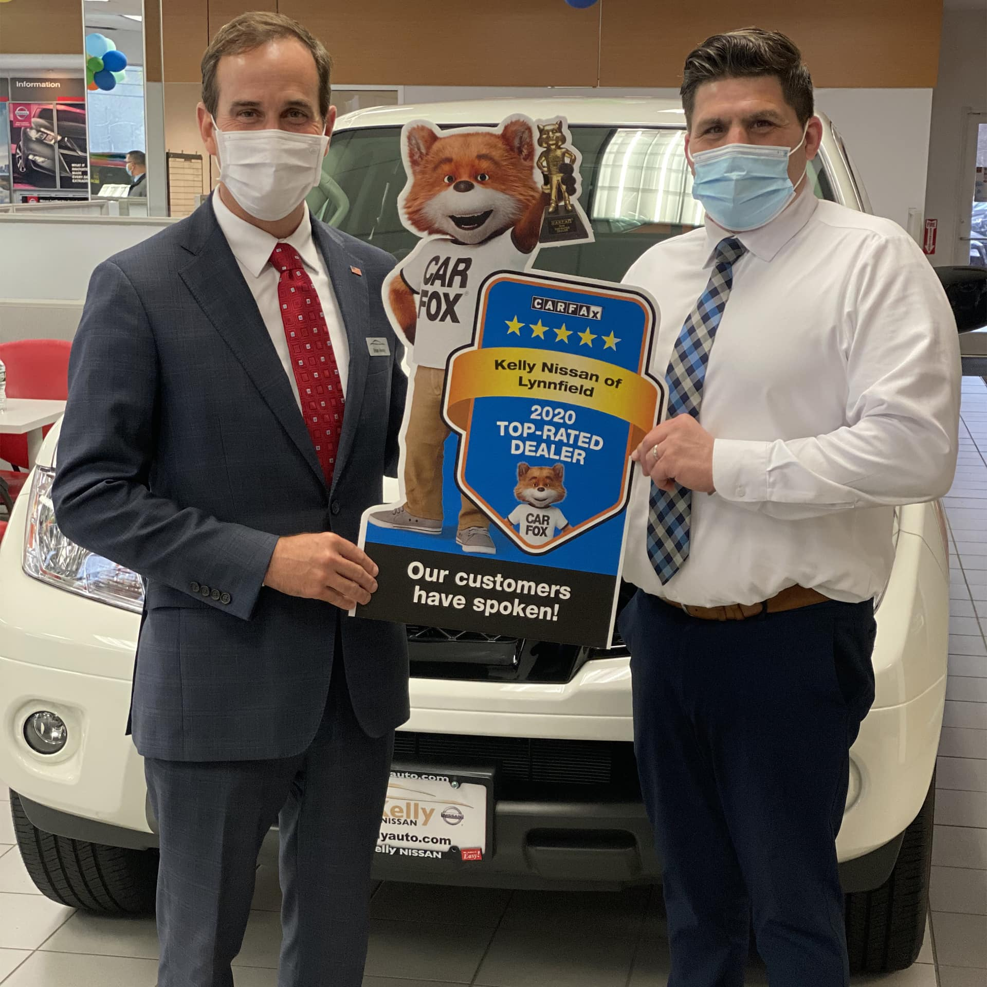 Kelly Automotive Group CEO, Brian Heney, and Sales Manager Vinny Varacalli, Posting with CARFAX Sign at Kelly Nissan of Lynnfield