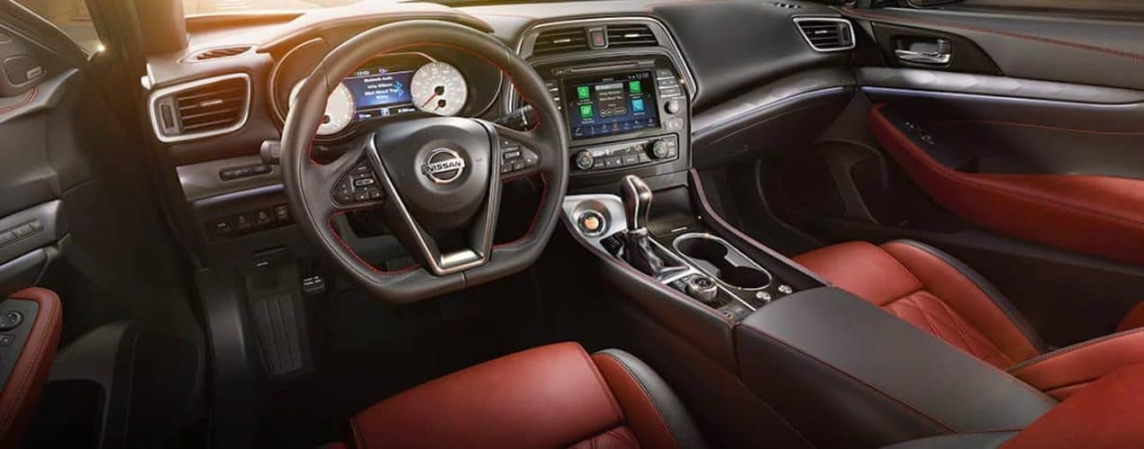 The black and red interior of a 2021 Nissan Maxima is shown.