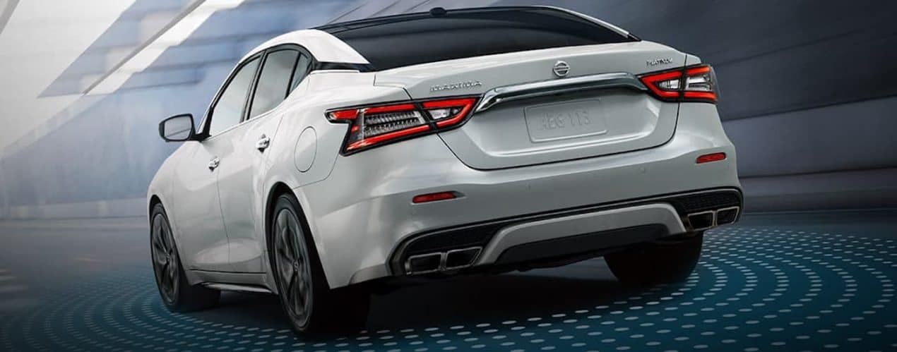 The rear of a white 2021 Nissan Maxima is shown with simulated safety dots around it.