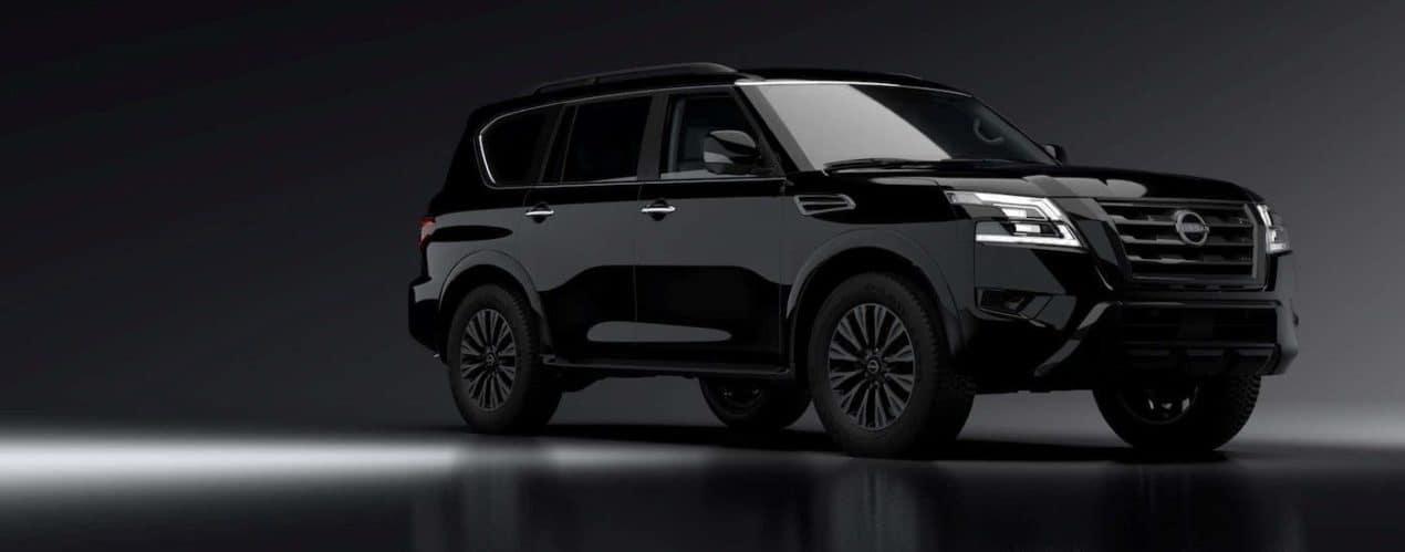 A black 2021 Nissan Armada is shown in a dark room.
