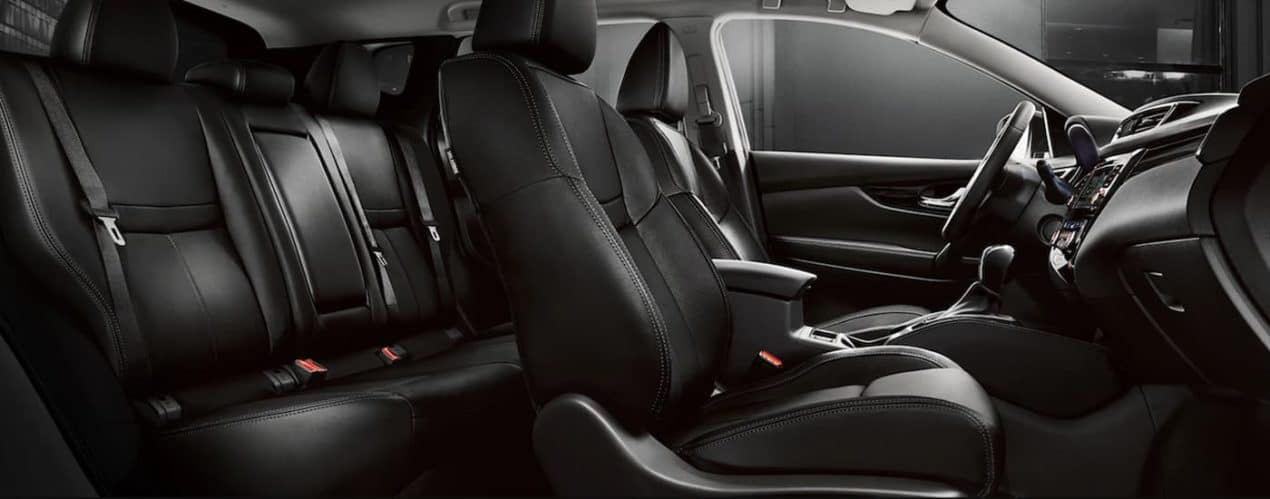 The black interior of a 2021 Nissan Rogue Sport is shown.