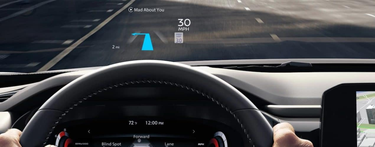 The digital dashboard is shown on the windshield in a 2022 Nissan Pathfinder.