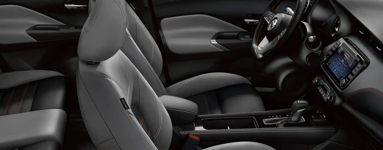 The grey and black interior is shown in a 2021 Nissan Kicks.