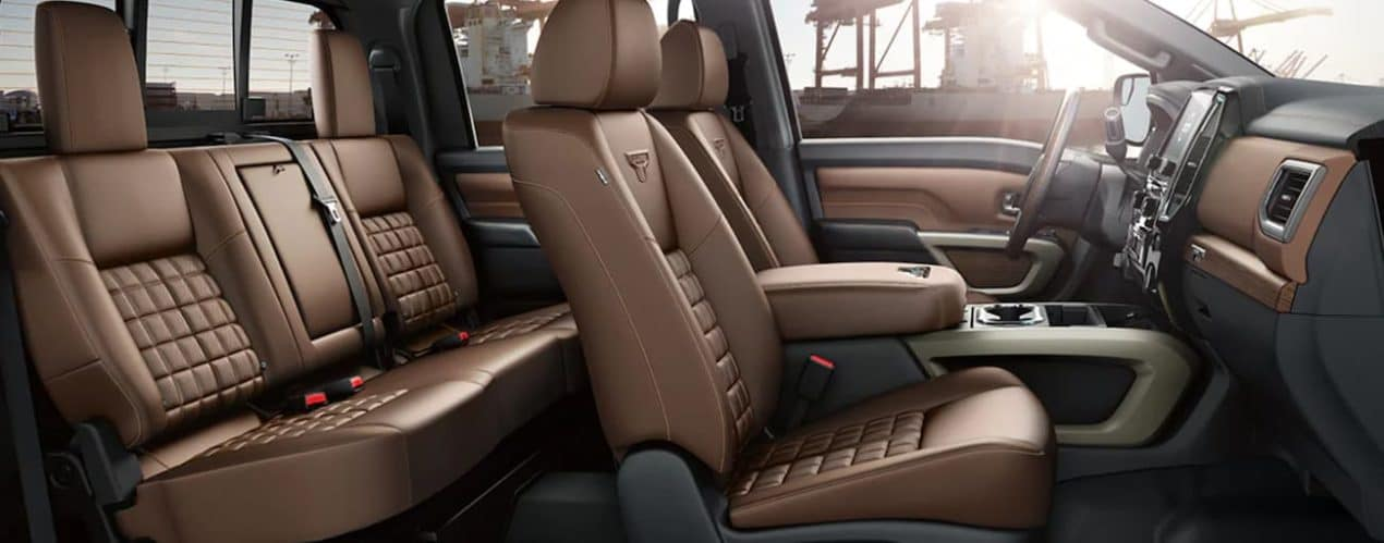 The brown interior of a 2021 Nissan Titan XD is shown from the side.