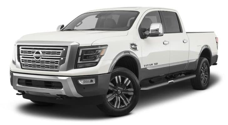 A white 2021 Nissan Titan XD is angled left.