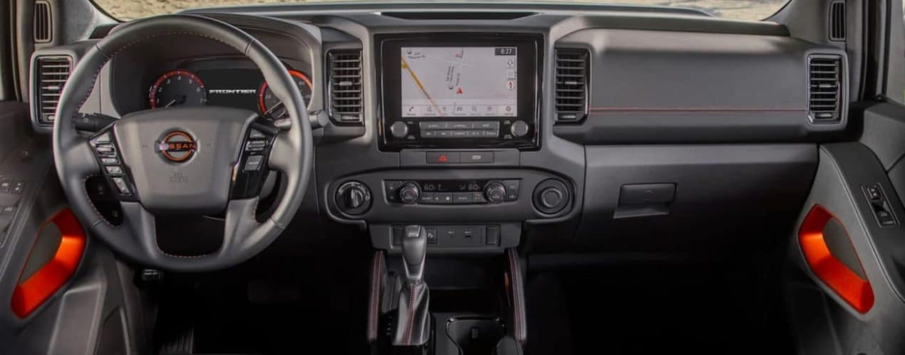 The dashboard and screen are shown in a 2022 Nissan Frontier.