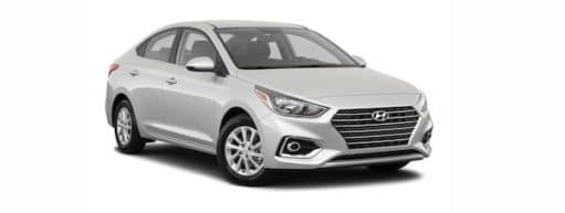 A silver 2021 Hyundai Accent is angled right.