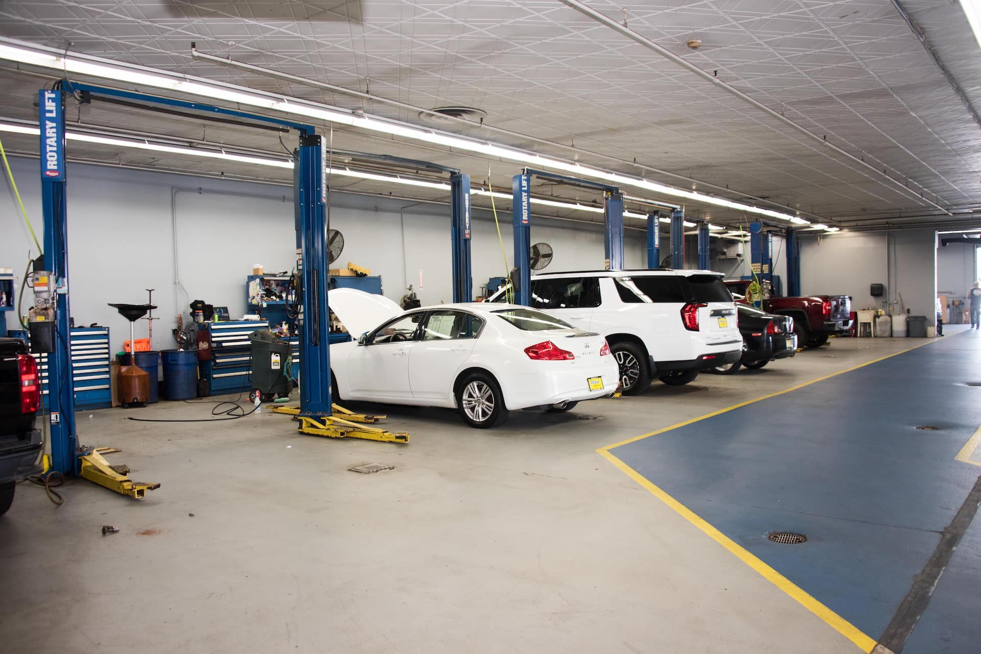 Vehicles being worked on in the service center.